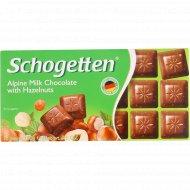 Шоколад молочный «Schogetten» альпийский с лесными орехами, 100 г.